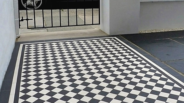 Black and white checked tiles in a front garden