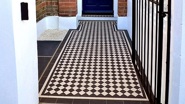 New installation of traditional black and white Victorian path tiles