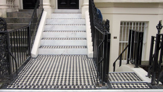 Steps - A Georgian town house entrance is enhanced with the addition of black and white checker board tiles along with marble step risers.