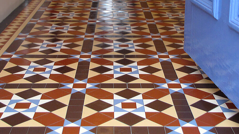 Traditional Victorian style hall floor tiles - A classic multi-colour geometric design .