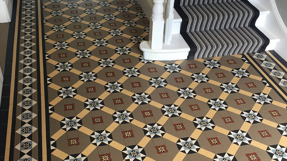 Decorative Victorian encaustic tile design for a hallway floor, with stair runner.