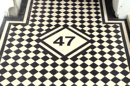 water jet cut tiles showing house number