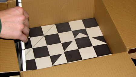 Bespoke sheeted black and white tiles being put into boxes