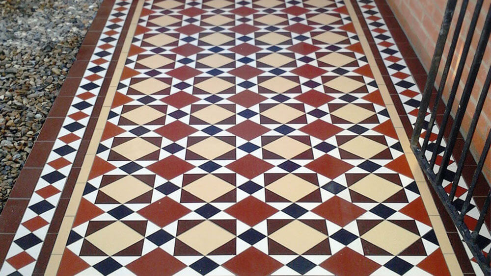 Edwardian style ceramic path tiles - Southwark 100: Black, Red, Brown, Cognac and White, a traditional design based around 100mm squares with 50mm diamond border. Our range of reproduction tiles supplied bespoke sheeted to accelerate the installation whilst maintaining accuracy.
