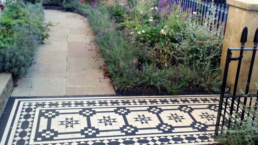 Decorative Georgian style geometric path tiles - Battersea pattern: Black and White, a traditional Georgian design with 50mm diamond border and four lines. Composed predominantly of 70mm and 35mm squares. We were asked to match an original path that our client had seen locally. Quite often whole streets would have had the same tiled path designs, so if you are intending to install new tiles in a period pattern, looking around the local area is recommended.
