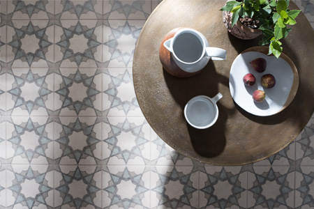 Cement effect porcelain tiles printed with decorative patterns