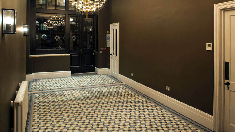 Contemporary geometric hall floor ceramic tiles - Rogers: A modern design composed of squares and triangles.