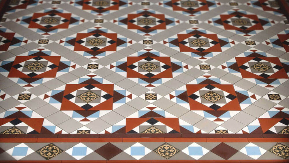 Decorative Victorian encaustic tile design - Calton pattern: Black, Pale Grey, Super White, Red, Brown and Pale Blue, a traditional pattern featuring decorative 50mm and 70mm encaustic tiles with an elaborate 70mm Barlow diamond border.