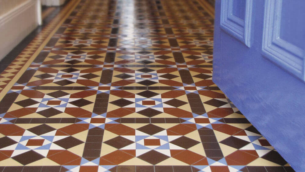 Traditional Victorian style hall floor tiles - Finsbury pattern: Brown, Red, Black, White, Cognac and Blue, a classic design with 50mm diamond border and two lines. Supplied as 'Standard Sheets' - the tiler plans the design on-site, trimming the tessellating sheets to fit the area.