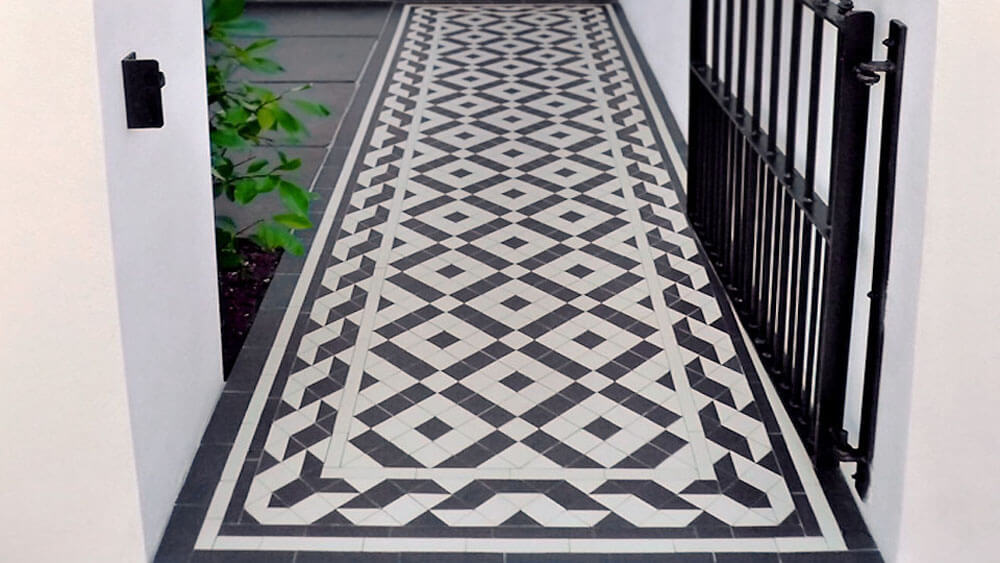 Victorian black and white path tiles - Colliford 50 pattern: a traditional design with 50mm Snake / Rope border. Bespoke sheeted supply for a high quality installation.