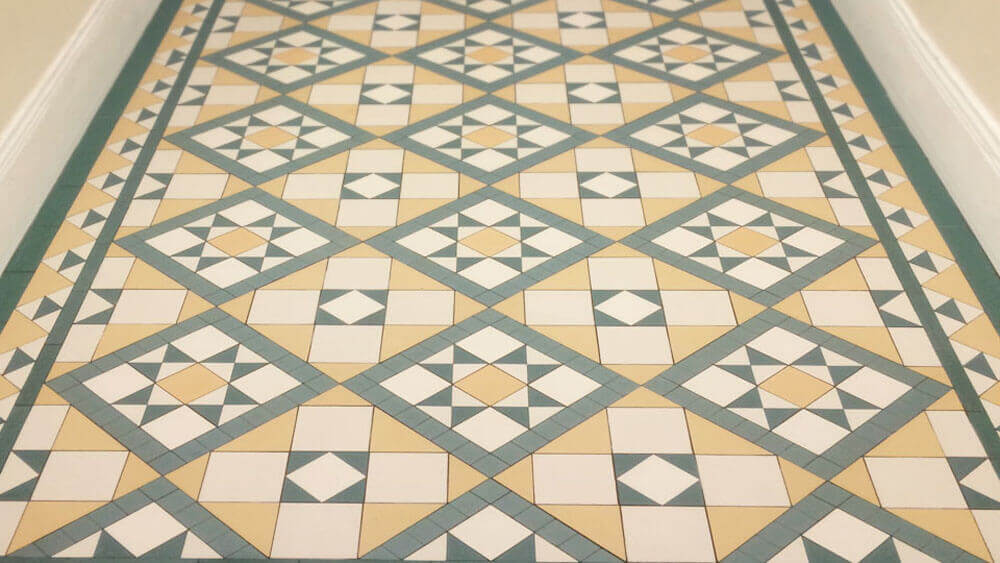 Victorian style star and box motif ceramic hall floor tiles - Wimbledon pattern: White, Cognac, Green and Dark Green a grand Victorian design with a wide decorative border. Supplied as bespoke sheeted tiles for an the entrance hall of an office block in central London.